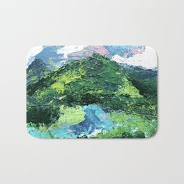 Gunnison: a vibrant acrylic mountain landscape in greens, blues, and a splash of pink Bath Mat