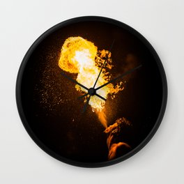 profile image of a fire eater spitting flames into the sky Wall Clock
