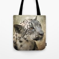 snow leopard Tote Bags featuring Snow Leopard by Jai Johnson
