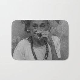 Old lady smoking cuban cigar in Havana Bath Mat