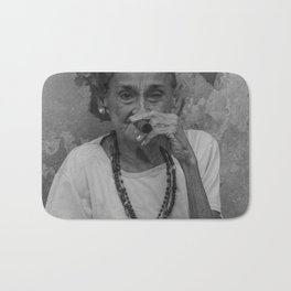 Old lady smoking cuban cigar in Havana Bath Mat