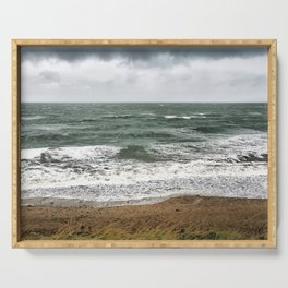 Land and sea under stormy clouds Serving Tray