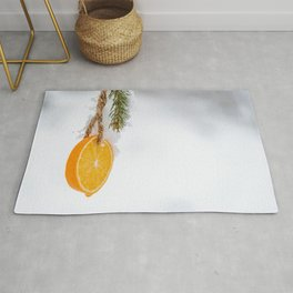 Cold frosty Orange Slice hanging in a tree for the holidays Rug