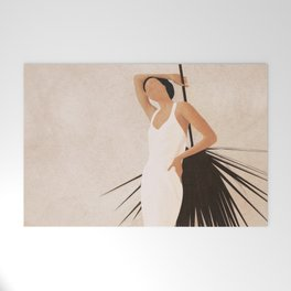 Minimal Woman with a Palm Leaf Welcome Mat