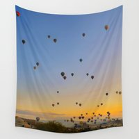 ballon Wall Tapestries featuring Colorful hot air balloons against blue sky at Cappadocia Turkey by natalia.maroz