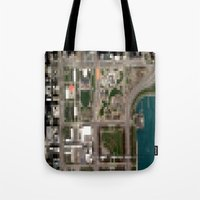chicago map Tote Bags featuring Chicago by Mark John Grant