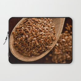 Brown flax seeds portion on wooden spoon Laptop Sleeve