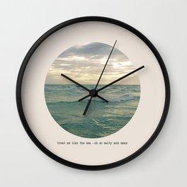 treat me like the sea Wall Clock