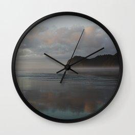 golden hour at piha beach Wall Clock