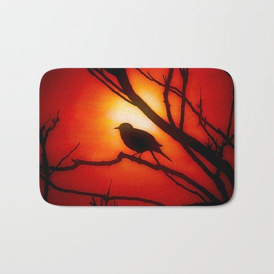 Blackbird in the morning light Bath Mat