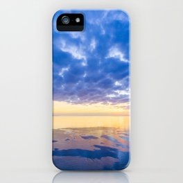 Sunset over ocean - blue cloudy sky, sun, and smooth water iPhone Case