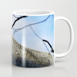 Mountain through the trees Coffee Mug