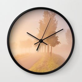 Foggy sunrise in typical polder landscape in The Netherlands Wall Clock