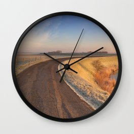 II - Typical Dutch landscape with a dike, in winter at sunrise Wall Clock