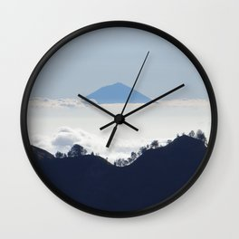 Island in the clouds Wall Clock