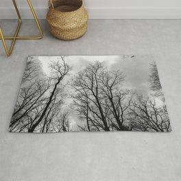 Creepy black and white trees Rug