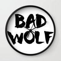 bad wolf Wall Clocks featuring Bad Wolf  by Freak Clothing