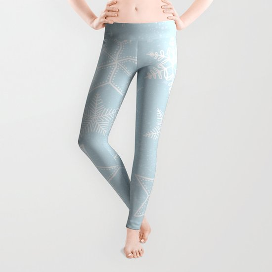 Snowflakes on light blue background Leggings