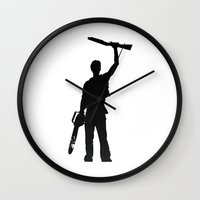 evil dead Wall Clocks featuring Evil dead This is my boomstick by Komrod