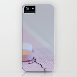 Some colored tablets on an electrocardiogram strip iPhone Case