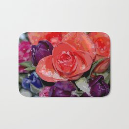 Snow settling on a top of Bouquet of flowers Bath Mat
