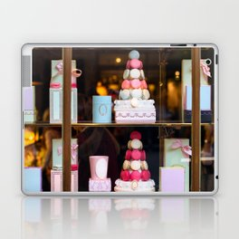 Beautiful colorful tasty macaroons cakes sweets and presents in the boxes display in window at the  Laptop & iPad Skin