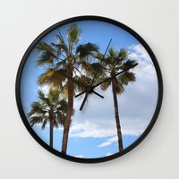 palm trees Wall Clocks featuring Palm Trees by Rebecca Bear