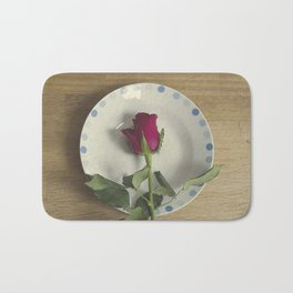Red rose on a plate Bath Mat
