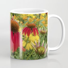 Red Echinacea standing out in a field of gold and orange Coffee Mug