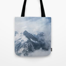 Misty mountain tops in the Alps Tote Bag