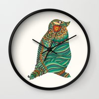 ethnic Wall Clocks featuring Ethnic Penguin by Pom Graphic Design