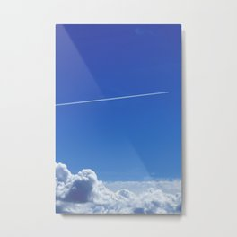 The trail of a flying airplane Metal Print