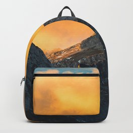 Last light on mountains before sunset Backpack