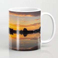 Sunrise arcross the water Mug