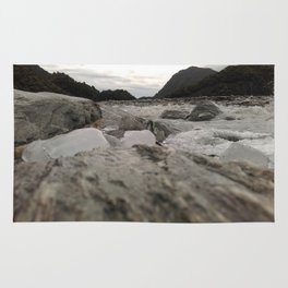 franz josef glacier in new zealand river with ice cubes rough cold Rug