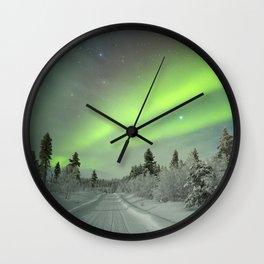 Aurora borealis over a track through winter landscape, Finnish Lapland Wall Clock