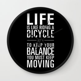 Life is like riding a bicycle. Black Background. Wall Clock