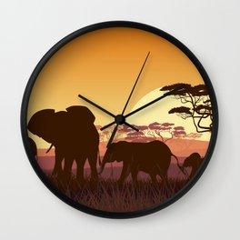 elephants in the African meadow Wall Clock
