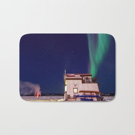 Northern Lights and house boat in Yellowknife Bath Mat