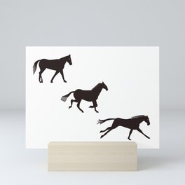 a horse runs Mini Art Print