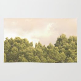 Tree tops and sky Rug