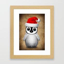 Baby Penguin Wearing a Santa Hat Framed Art Print