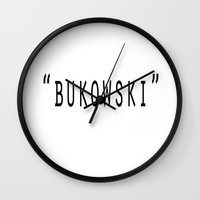 bukowski Wall Clocks featuring Bukowski by Sofia Gerona