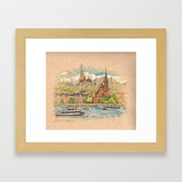 Castle and churches on riverside with boats Framed Art Print
