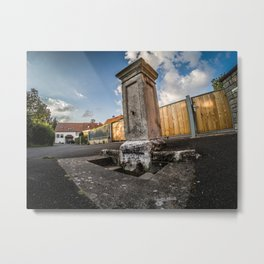 Old fountain in the middle of the village Metal Print