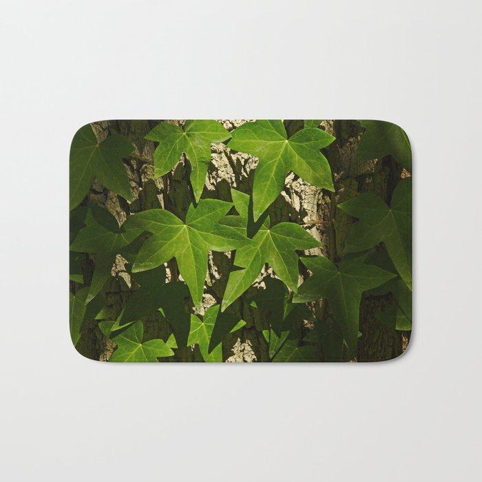 Sunny ivy leafs on a tree bark Bath Mat