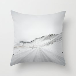 Winter road and mountain view in Iceland Throw Pillow