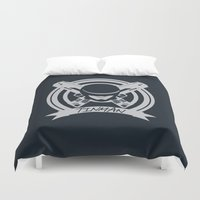 robocop Duvet Covers featuring Tinman Coat of Arms by Suuki