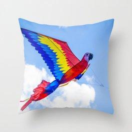 Beautiful Red Scarlet Macaw Kite Taking Flight during the Indian Kite Festival of Uttarayan Throw Pillow