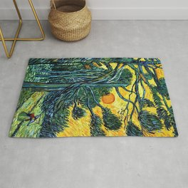 Pine Trees against a Red Sky with Setting Sun by Vincent van Gogh Rug